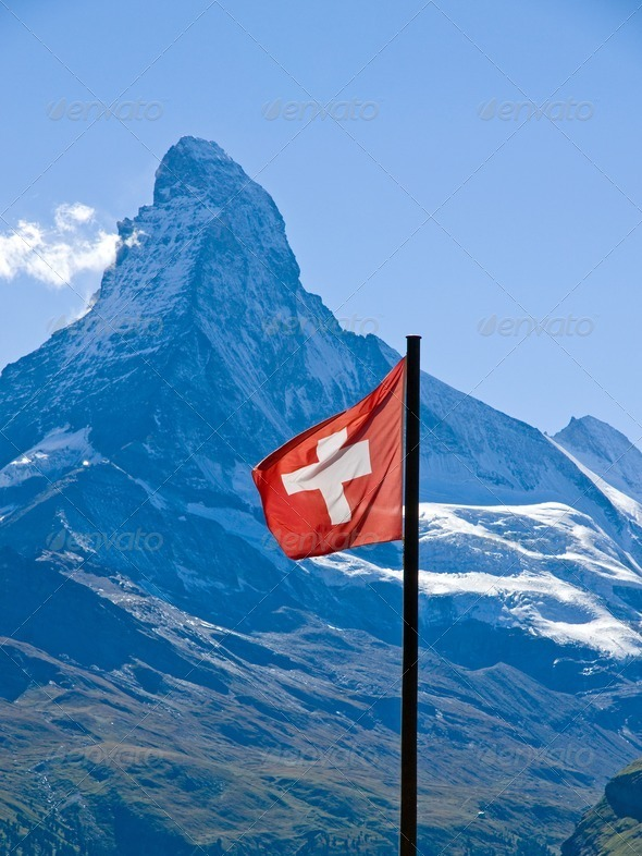 Swiss flag with the Matterhorn - Stock Photo - Images