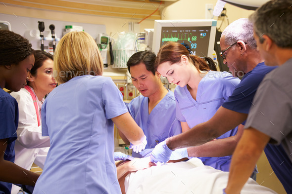 Medical Team Working On Patient In Emergency Room - Stock Photo - Images