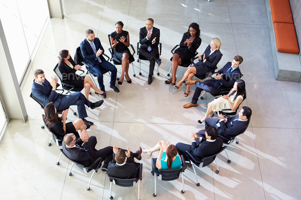 Multi-Cultural Office Staff Applauding During Meeting - Stock Photo - Images