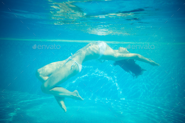 Underwater portrait of beautiful woman - Stock Photo - Images