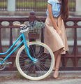 Young beautiful, elegantly dressed woman with bicycle - PhotoDune Item for Sale