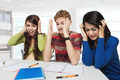 Three stress young students sitting together, isolated - PhotoDune Item for Sale