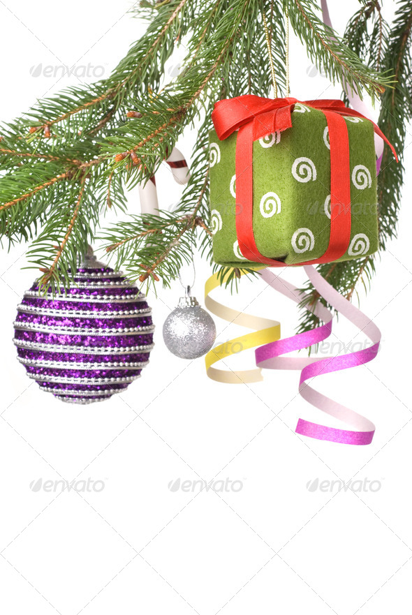 Christmas balls, gift and decoration on fir tree branch isolated - Stock Photo - Images
