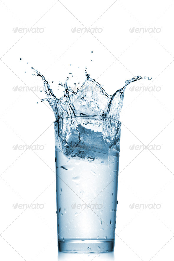 water splash in glass isolated on white - Stock Photo - Images