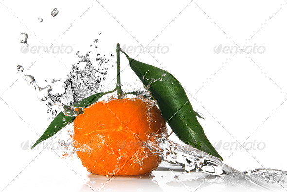 Tangerine with water splash isolated on white - Stock Photo - Images