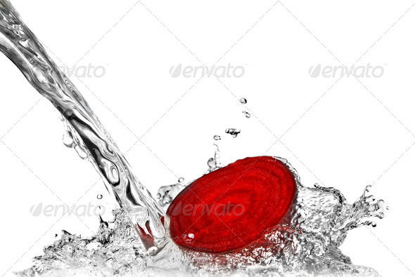 red beet with water splash isolated on white - Stock Photo - Images