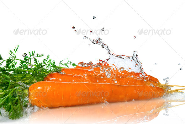 fresh water splash on carrot isolated on white - Stock Photo - Images