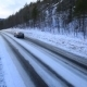 The Car Rides On a Winter Road Among The Woods And - VideoHive Item for Sale
