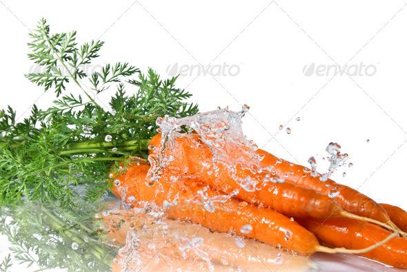 fresh water splash on carrot isolated on white - Stock Photo - Images