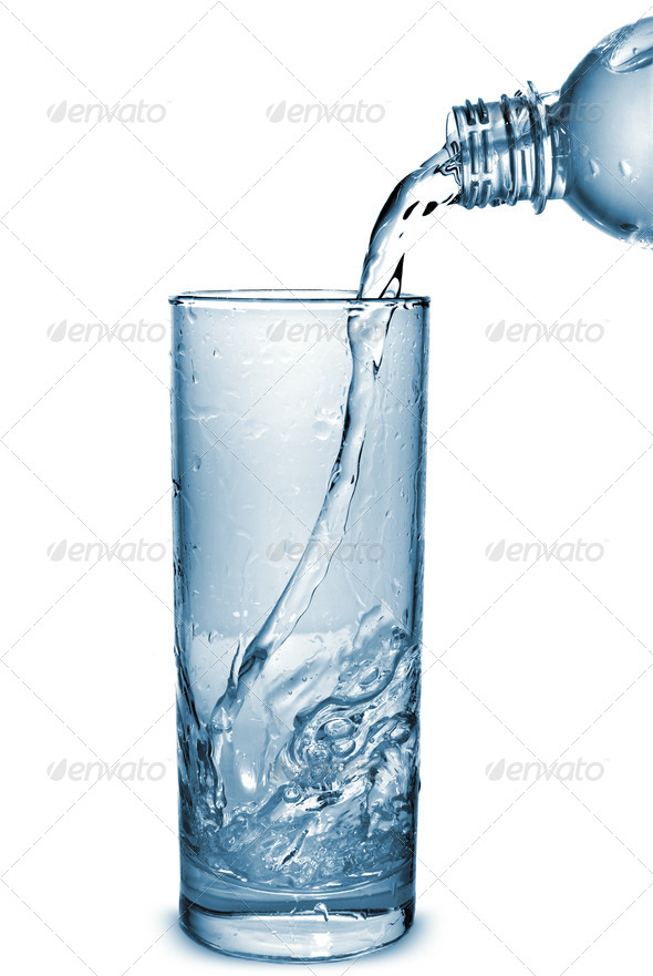 water pouring into glass from bottle isolated on white - Stock Photo - Images