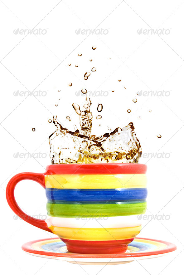 color cup and splash of tea isolated on white - Stock Photo - Images