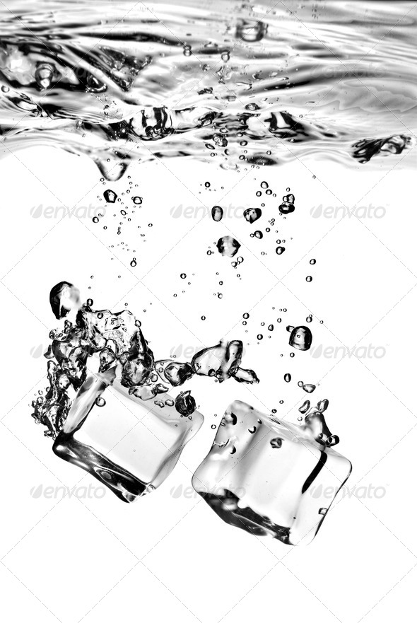 ice cubes dropped into water with splash isolated on white - Stock Photo - Images