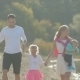 Happy Family With Two Kids Walking Along The Shore - VideoHive Item for Sale