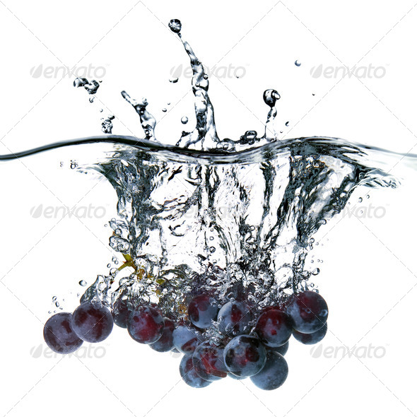 blue grape dropped into water with splash isolated on white - Stock Photo - Images