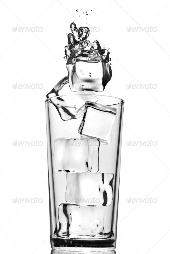 ice cubes dropped into glass with bubbles isolated on white - Stock Photo - Images