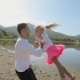 Father Whirls His Daughter Near The Lake - VideoHive Item for Sale