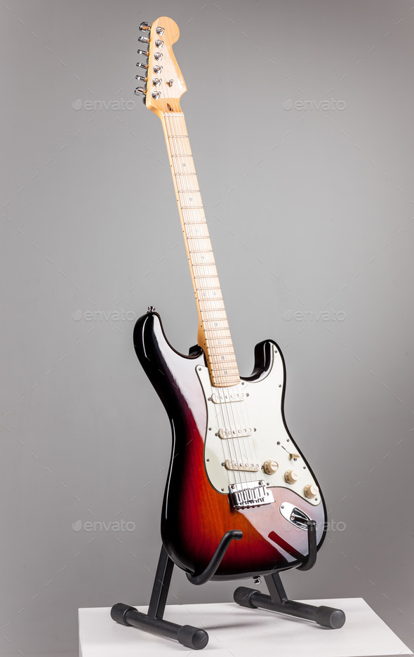 Electric guitar isolated on gray background - Stock Photo - Images