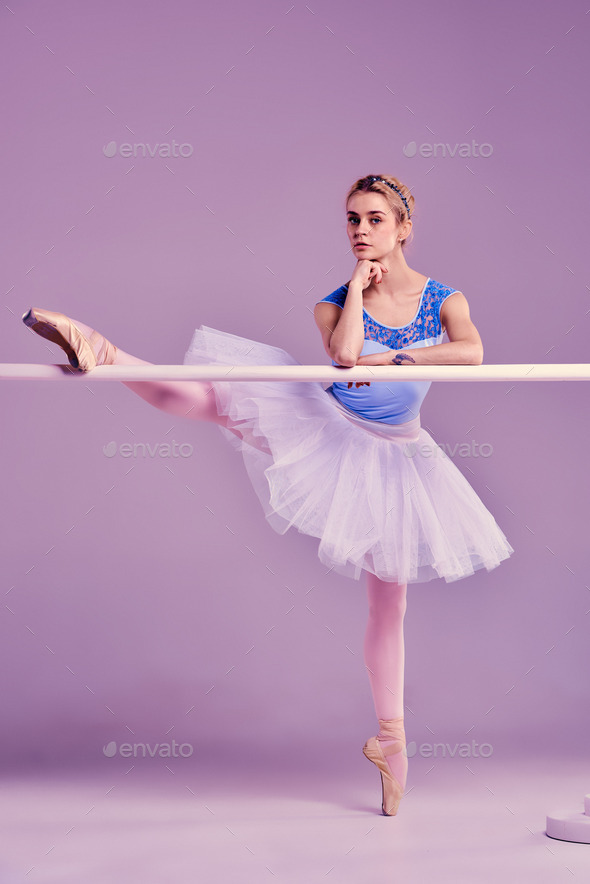 classic ballerina posing at ballet barre - Stock Photo - Images