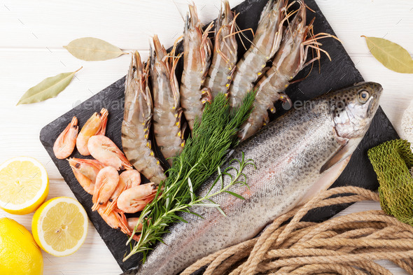 Fresh raw sea food with spices - Stock Photo - Images