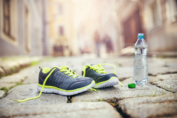 Running shoes and bottle of water - Stock Photo - Images