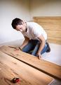 Handyman installing wooden floor - PhotoDune Item for Sale