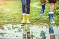 Details of young couple walking in muddy nature.
