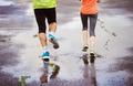 Couple running in rainy weather