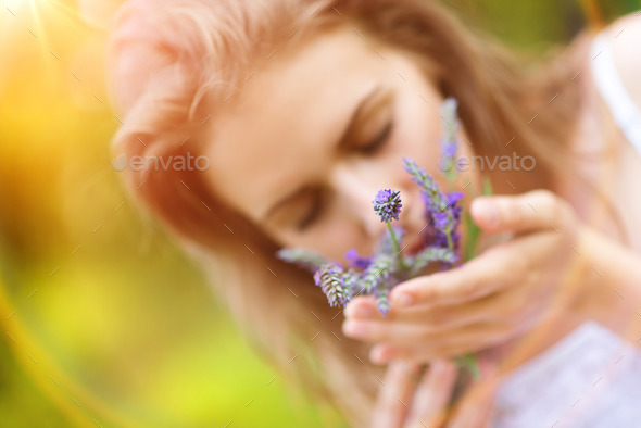 Woman holding flowers - Stock Photo - Images