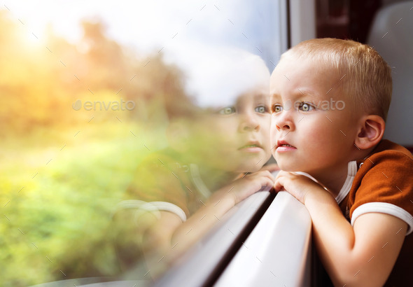 Little boy travelling in train - Stock Photo - Images