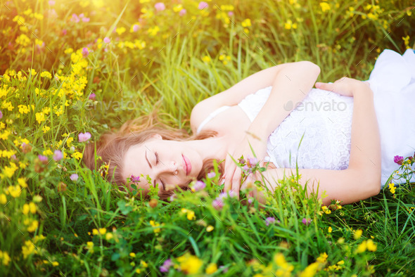 Beautiful woman on a meadow. - Stock Photo - Images