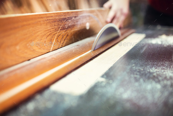 Carpenter sawing wooden planks - Stock Photo - Images