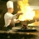 Male Chef Is Cooking Flambe In Restaurant Kitchen - VideoHive Item for Sale