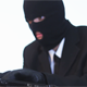 Hacker in a Mask and Gloves Hacking Laptop - VideoHive Item for Sale
