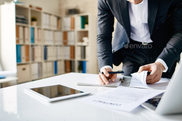 Looking through papers - Stock Photo - Images