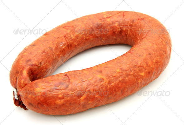 Tasty sausage is curtailed by a ring lies on a white background - Stock Photo - Images