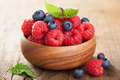 fresh berries raspberry blueberry in wooden bowl
