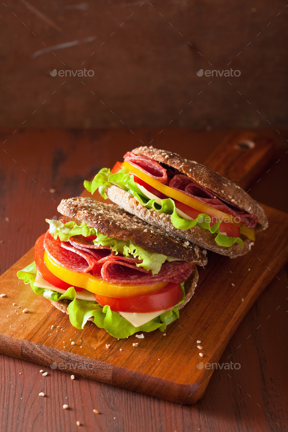 healthy sandwich with salami tomato pepper and lettuce - Stock Photo - Images