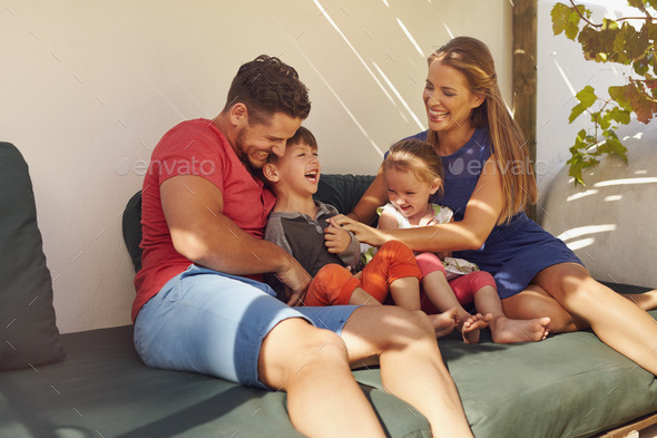 Happy young family spending time together - Stock Photo - Images
