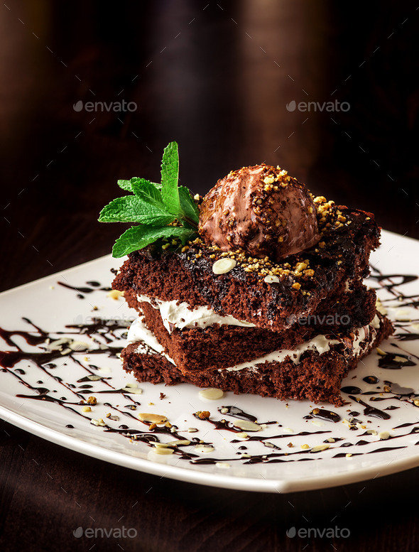 Chocolate brownie cake with a scoop of ice cream. - Stock Photo - Images