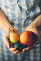 Hands holding fresh organic fruits. Retro colors - PhotoDune Item for Sale
