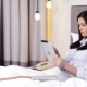 Businesswoman With Tablet Pc Lying In Bed At Hotel - VideoHive Item for Sale