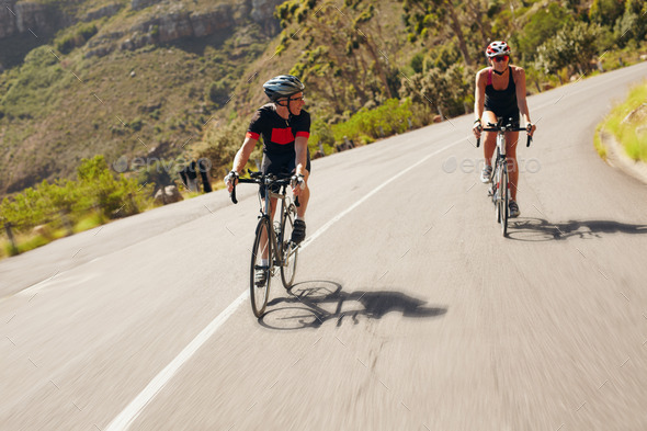 Two cyclist practicing for triathlon race - Stock Photo - Images