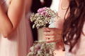 Hands of bridesmaid holding a beautiful gypsophila bouquet - PhotoDune Item for Sale
