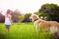 Young girl with golden retriever walking away - PhotoDune Item for Sale
