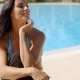 Cheerful Woman At The Poolside Smiling At Camera - VideoHive Item for Sale