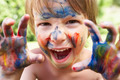 Portrait Of Boy With Painted Face and Hands - PhotoDune Item for Sale