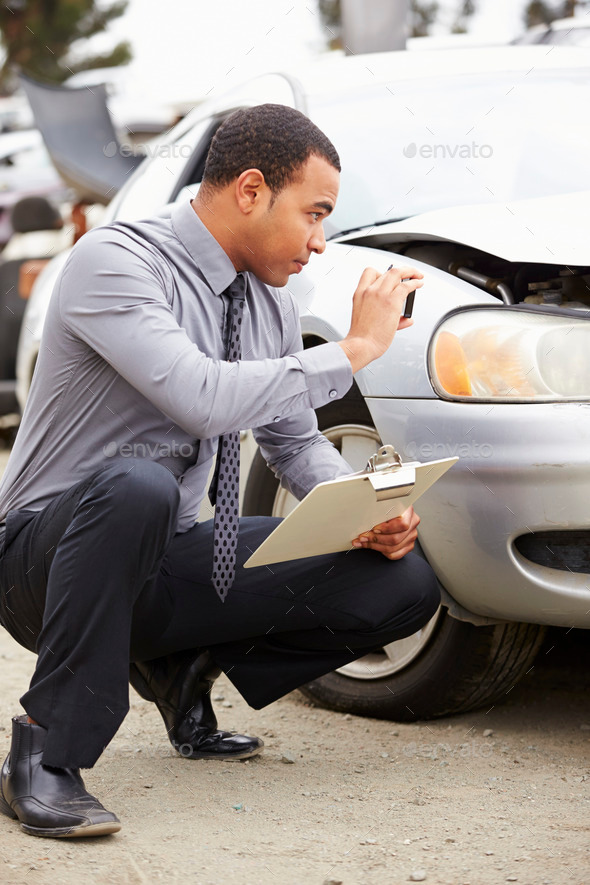 Loss Adjuster Taking Photograph Of Damage To Car - Stock Photo - Images