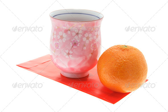 Mandarin, Teacup and Red Packet - Stock Photo - Images