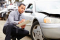 Loss Adjuster Inspecting Car Involved In Accident - PhotoDune Item for Sale