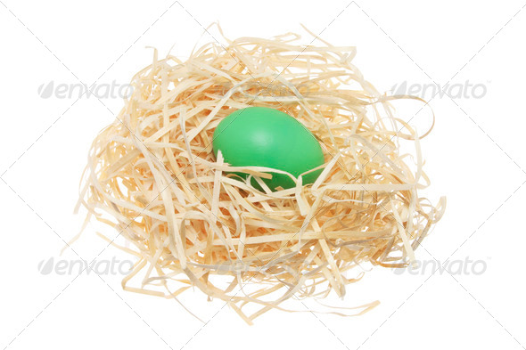 Easter Egg on Straw Nest - Stock Photo - Images